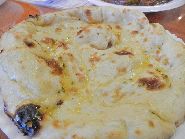 Naan bread - they have regular and one with garlic that's basted with olive oil