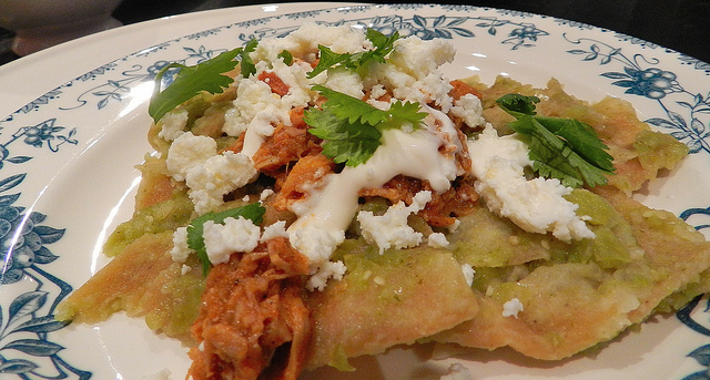 chilaquiles verdes with carnitas, crema (Mexican cream aka crack) and queso fresco - this was obviously very healthy