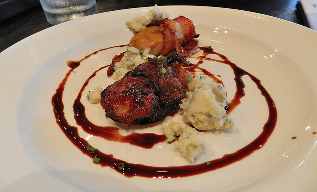 Pork bely with bacon wrapped scallops, blue cheese and balsamic