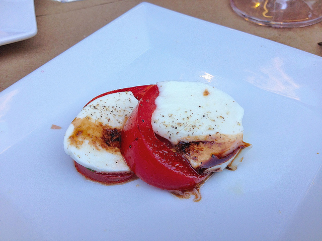 Portion of the caprese salad; sometimes my dining companions don't play by the rules...